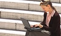 Image 2 of 3 student using laptop